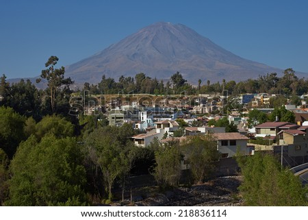Volcano Misti (5822m) towering over the suburbs of Arequipa in Peru - stock photo