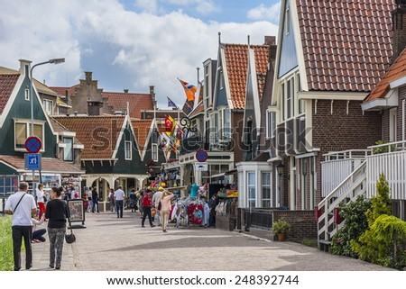 VOLENDAM, NETHERLANDS - JUNE 18, 2014: Beautiful view of a Volendam street: urban subjects. Volendam - a small town that has preserved the tradition of Dutch fishing villages. - stock photo