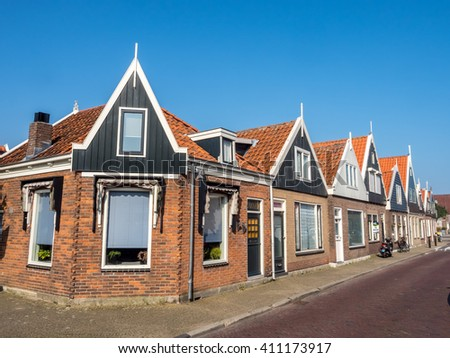 VOLENDAM - OCTOBER 4: City scene, yacht pier and fisherman village in Volendam, small cute town of Netherlands, was taken on October 4, 2015.