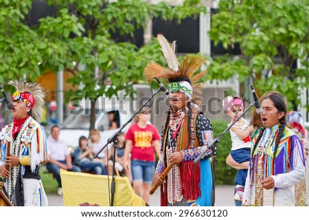 VOLGOGRAD - JUNE 20: The Indians of South America play ethnic music and sing folk songs on the area of the Russian city. June 20, 2014 in Volgograd, Russia. - stock photo