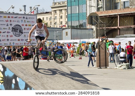 VOLGOGRAD - MAY 24: Athlete is an extreme sports enthusiast performs trick on BMX bike with rotation on front wheel. Annual competition for Cup of Europe city Mall . May 24, 2015 in Volgograd, Russia. - stock photo
