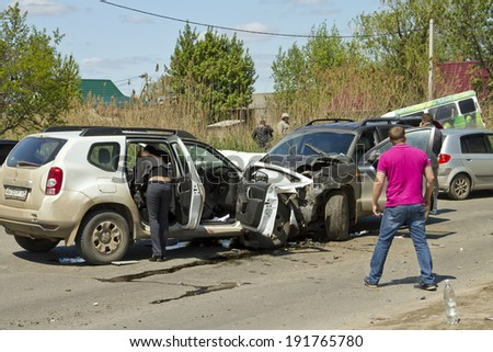 VOLGOGRAD - MAY 7: Head-on collision of two cars on the street Bamboo, accident seriously injured people. May 7, 2014 in Volgograd, Russia. - stock photo