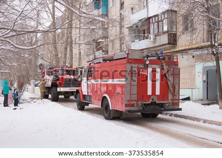 Volgograd, Russia - January 24, 2016: Two cars Fire Service of EMERCOM of Russia arrived to the challenge on suspicion of fire in high-rise apartment building