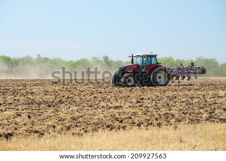 "Volgograd, Russia - JULY 31, 2014: Demonstration of agricultural machinery in ""Fild Days"" -annual review of agricultural machinery, it took place on July 31 - August 1, 2014, Volgograd, Russia"