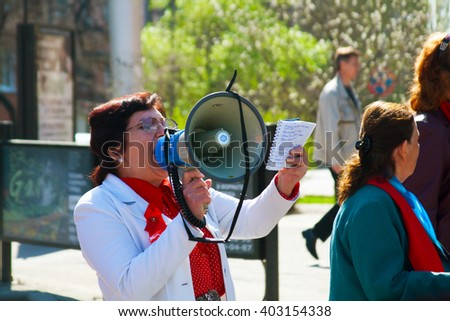 VOLGOGRAD, RUSSIA - MAY 1, 2011: Demonstrator with a megaphone in the May day demonstration in Volgograd - stock photo