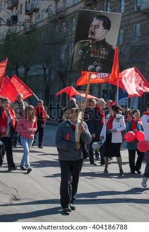 VOLGOGRAD, RUSSIA - MAY 1, 2011:Man with portrait of Soviet dictator Josef Stalin takes part in the May day demonstration in Volgograd - stock photo
