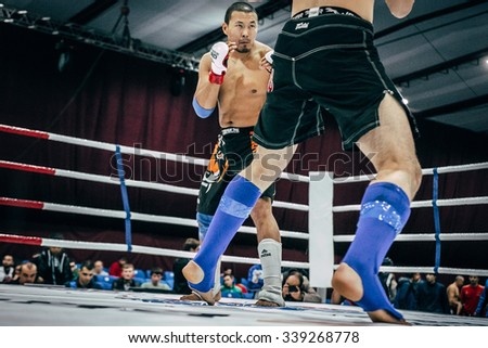 Volgograd, Russia - October 24, 2015: fighting stand-up athlete mixed martial arts during Championship of Russia on mixed martial arts - stock photo