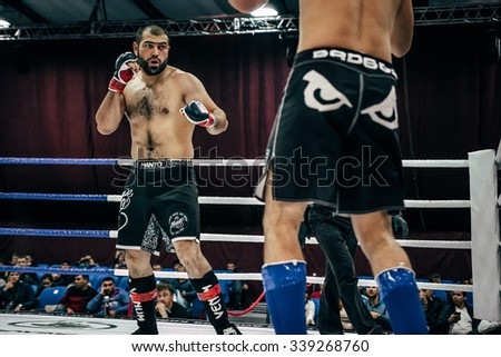 Volgograd, Russia - October 24, 2015: fighting stand-up in ring MMA fighters during Championship of Russia on mixed martial arts - stock photo