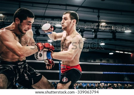 Volgograd, Russia - October 24, 2015: mixed martial arts fighter gets a punch to his opponent during Championship of Russia on mixed martial arts - stock photo