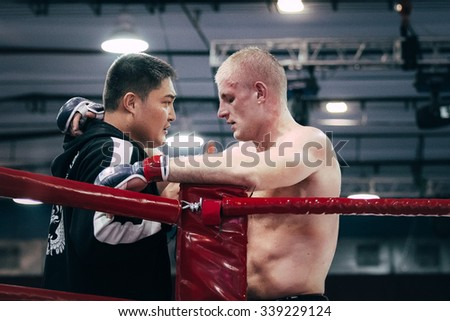 Volgograd, Russia - October 24, 2015: MMA athlete and coach during a timeout during Championship of Russia on mixed martial arts - stock photo