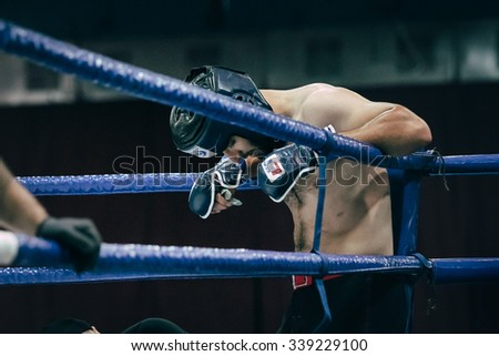 Volgograd, Russia - October 24, 2015: MMA fighter stands in corner of ring before fight during Championship of Russia on mixed martial arts - stock photo
