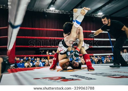 Volgograd, Russia - October 24, 2015: MMA fighters spend in ring match during Championship of Russia on mixed martial arts - stock photo