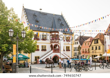 VOLKACH, GERMANY - August 20: Tourists at the historic old town of Volkach, Germany on August 20, 2017. Volkach is famous for its annual wine festival.