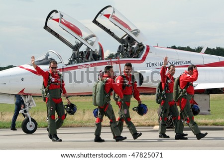 VOLKEL, NETHERLANDS - JUNE 16: Turkish Stars after performing on the Royal Netherlands Air Force Days June 16, 2007 in Volkel, Netherlands. - stock photo