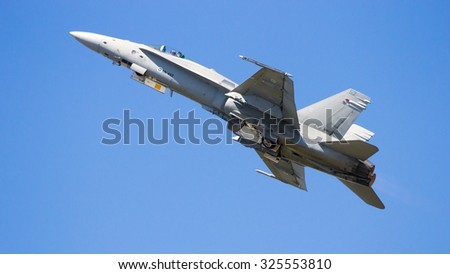 VOLKEL, THE NETHERLANDS - JUN 15, 2013: Finnish Air Force Boeing F-18 Hornet taking off at the Dutch Air Force Open Day. - stock photo