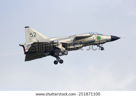 VOLKEL, THE NETHERLANDS - JUNE 15: Swedish Saab 37 Viggen take off at the Dutch Air Force Open Day on June 15, 2013 in Volkel, The Netherlands  - stock photo