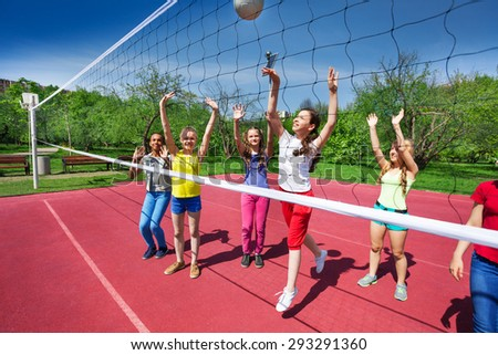 Volleyball game view with teenagers who play - stock photo
