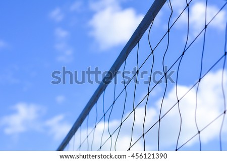 Volleyball net against a blue sky background