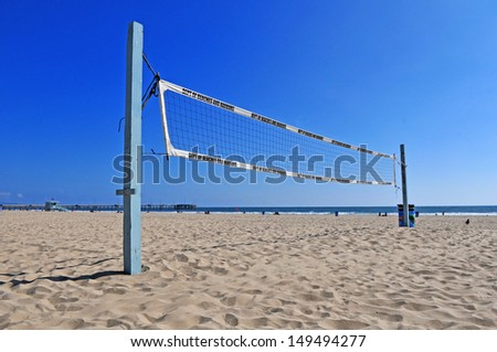 Volleyball net on a sand beach in summer