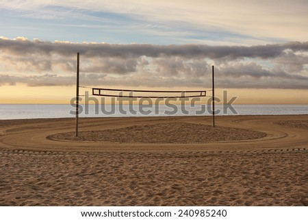 Volleyball net on Barcelona beach at sunrise - stock photo
