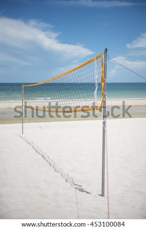 Volleyball net on beautiful tropical beach - stock photo