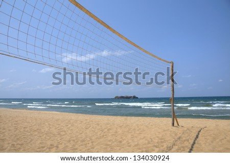 Volleyball net on empty Kande beach, Lake Malawi, Malawi, Africa - stock photo