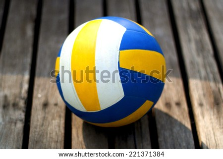 Volleyball on wooden boards