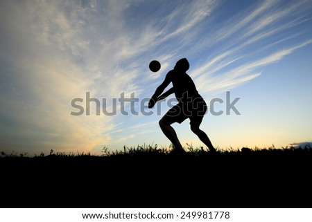 volleyball silhouettes at sunset play with ball - stock photo