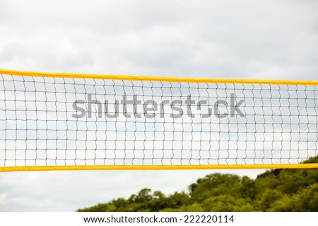 Volleyball summer sport equipment. Closeup of net netting wire on a sandy beach outdoor. Active lifestyle. - stock photo