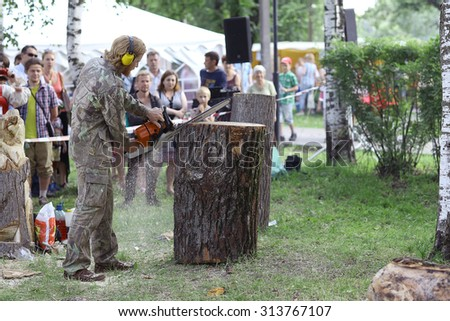 Vologda, RUSSIA â?? July 4: Master makes the saw wood sculpture on July 4, 2015, in Vologda, Russia