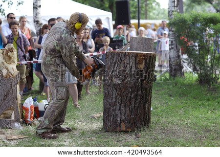 Vologda, RUSSIA - July 4: Master makes the saw wood sculpture on July 4, 2015, in Vologda, Russia