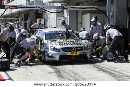 VOLOKOLAMSK, MOSKOW REGION - JULY 13, 2014: DTM (Deutsche Tourenwagen Masters) Moscow Raceway. Replacing Car Tires - stock photo