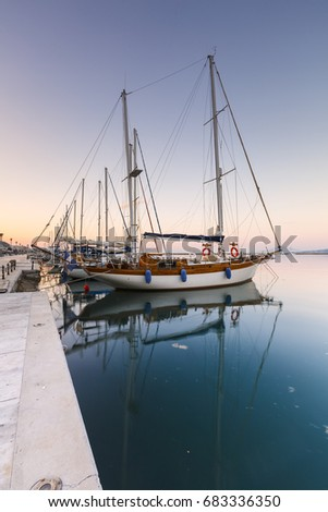 Volos, Greece - June 14, 2017: Sail boats in the harbour of Volos city as seen early in the morning.