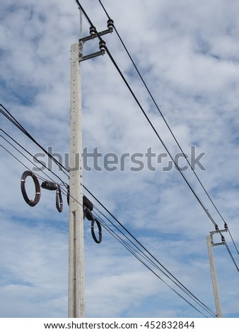 Voltage pole under blue sky
