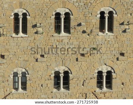 Volterra, Italian medieval town - view of the city centre - Palazzo della Prefettura facade - stock photo