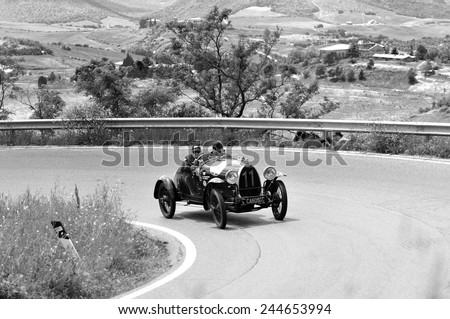 VOLTERRA (PI), ITALY - MAY 17: A Bugatti T23 Brescia takes part to the 1000 Miglia classic car race on May 17, 2014 near Volterra (PI). The car was built in 1923. Black and white image. - stock photo