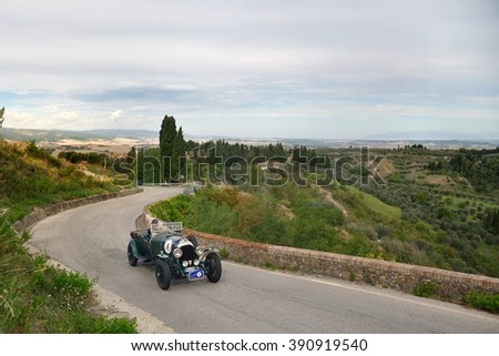 VOLTERRA (PI), ITALY - SEPTEMBER 19: A green Bentley 3 litre takes part to the GP Nuvolari classic car race on September 19, 2015 near Volterra (PI). The car was built in 1925. - stock photo