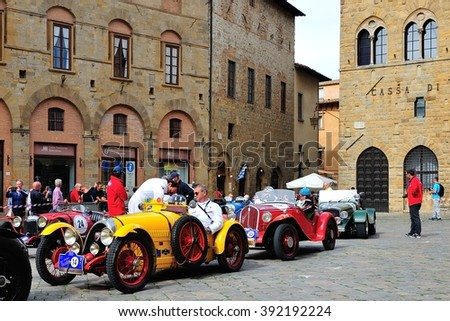 VOLTERRA (PI), ITALY - SEPTEMBER 19: A yellow BNC 527 Monza and other classics take part in the GP Nuvolari classic car race on September 19, 2015 in Volterra (PI). The BNC was built in 1927. - stock photo
