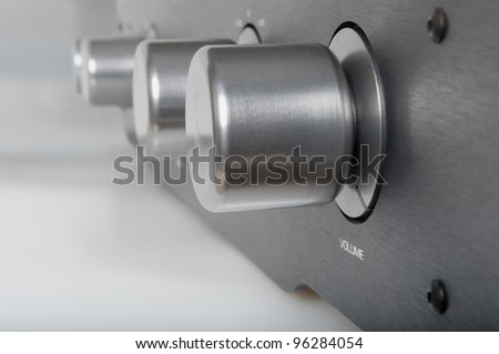 Volume Knob on Silver Metallic Amplifier - Shallow Depth of Field - stock photo