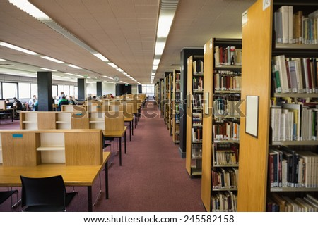Volumes of books on bookshelf in library at the university - stock photo