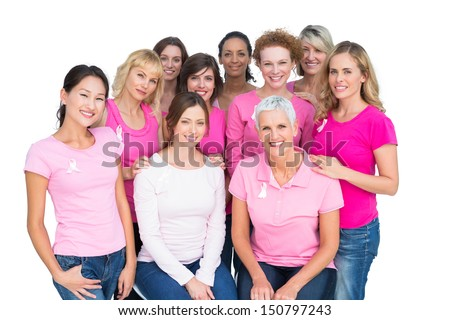 Voluntary cheerful women posing and wearing pink for breast cancer on white background
