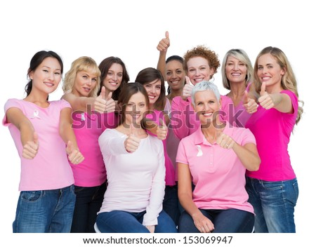 Voluntary women posing on white background and wearing pink for breast cancer