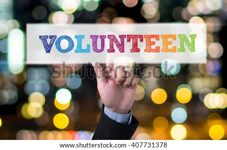 VOLUNTEEN Business man with hand pressing a button on blurred abstract background - stock photo