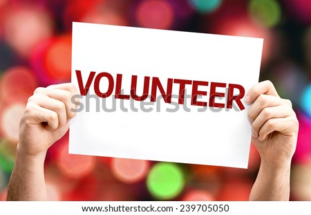 Volunteer card with colorful background with defocused lights - stock photo