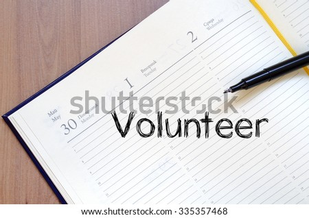 Volunteer text concept write on notebook