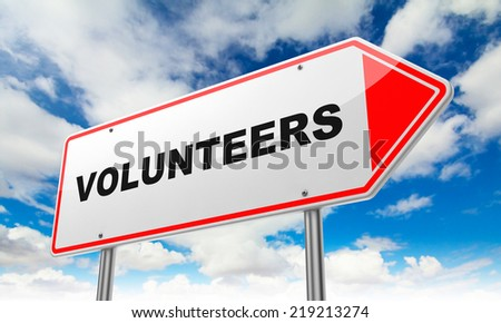 Volunteers - Inscription on Red Road Sign on Sky Background. - stock photo
