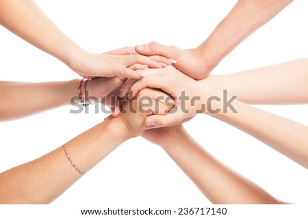 Volunteers joining hands isolated on white background