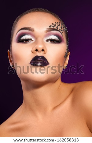 Voluptuous adult woman on purple background