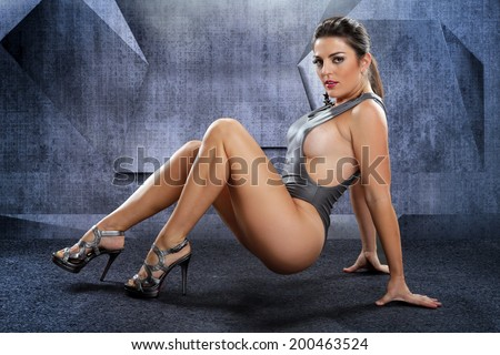 Voluptuous woman on a futuristic setting - stock photo