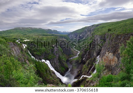 Voringsfossen waterfall with on the right the river Bjoreia and on the left the Tyssvikjo fall. The Bjoreia steeps down in the 2-300 metres deep valley .  - stock photo